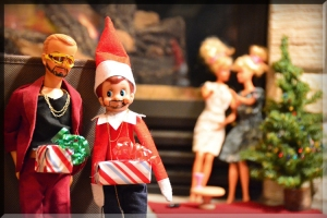 elf on a shelf dick in a box justin timberlake christmas santa hat barbie doll party scene naughty holiday dolls ken