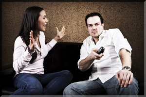 young-man-not-listening-remote-tv-game-distracted-sexy-hot-woman-hands-up-yelling